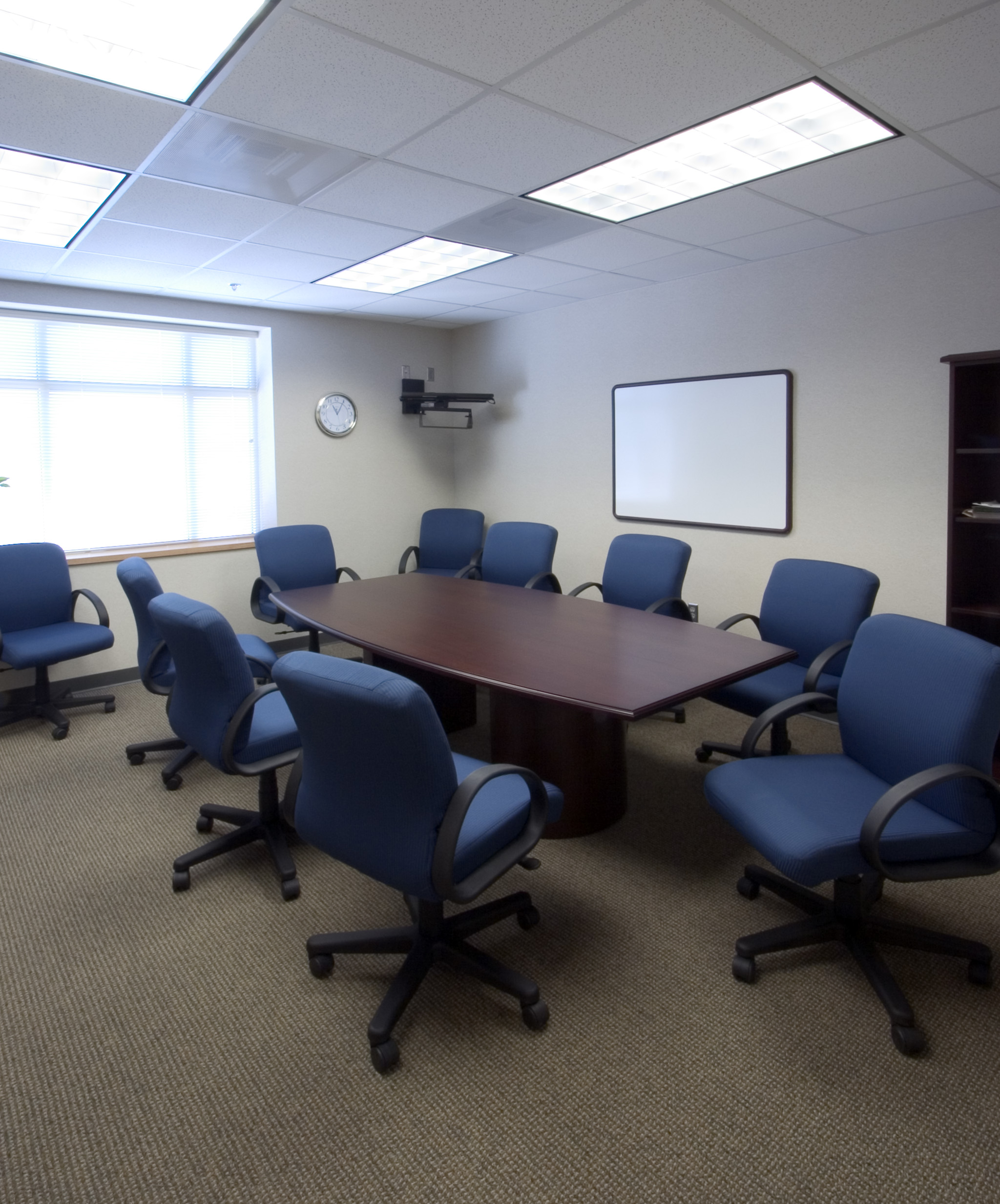 Chairs surround conference table